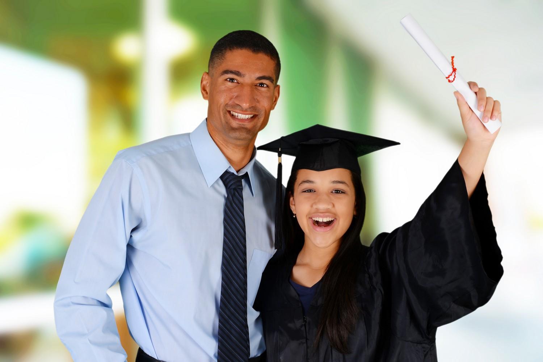 Student graduating standing by her teacherat school